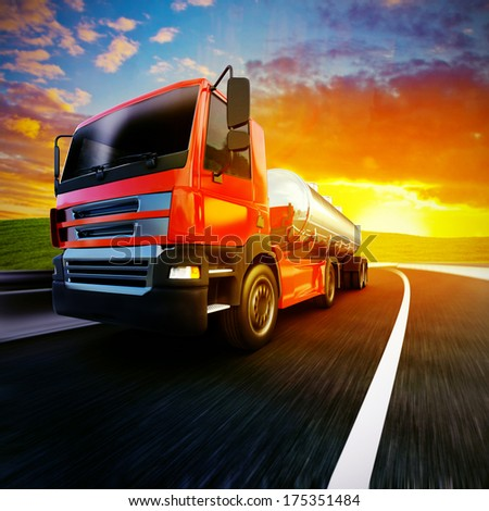 3d illustration of a red semi truck on blurry asphalt road under evening sky and sunset light - stock photo