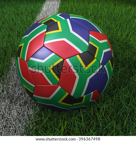 3D illustration of a soccer ball with South Africa flag on green field. - stock photo
