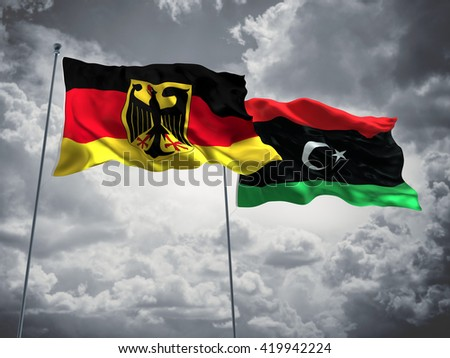 3D illustration of Germany & Libya Flags are waving in the sky with dark clouds  - stock photo