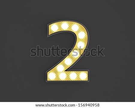 3d illustration of golden two number illuminated by lights on a gray background - stock photo