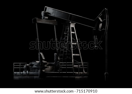 3D illustration of Oil derrick with dramatic light isolated on black