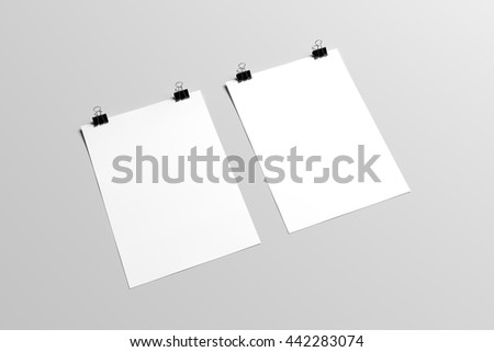 3D illustration of posters in with binder clips