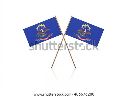 3D illustration of tiny North Dakota flag pair on gold sticks. Flag pair is standing on a reflective surface. Isolated on white background. With clipping path.