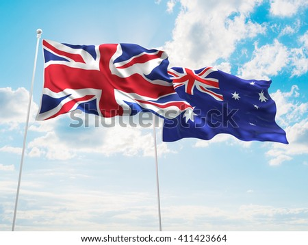 3D illustration of United Kingdom & Australia Flags are waving in the sky - stock photo