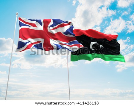 3D illustration of United Kingdom & Libya Flags are waving in the sky - stock photo