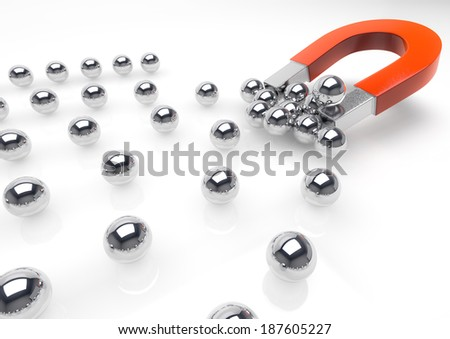 3d image of a magnet attracting marbles.(Concept of competition)
