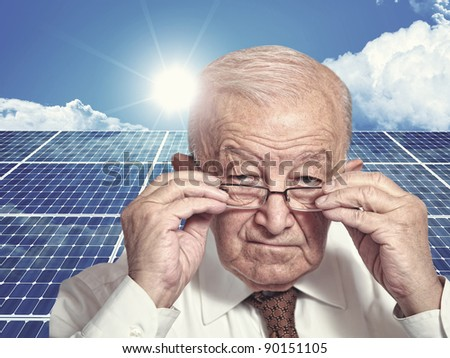 3d image of classic solar panel and old man portrait - stock photo