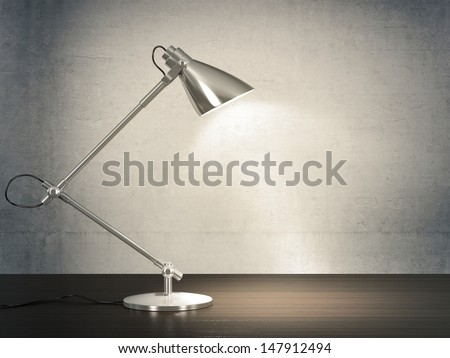 3D image of metal desk lamp on wooden desk next to the concrete wall. - stock photo