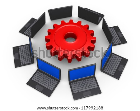 3d laptops around a cogwheel as network for common goal - stock photo