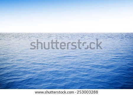 3d ocean with blue water and clear sky - stock photo