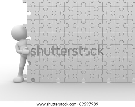 3d people - human character and a wall of the puzzle - jigsaw. This is a 3d render illustration - stock photo