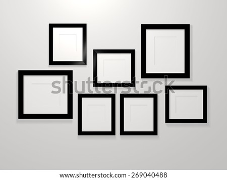 3d picture frames on a white wall - stock photo