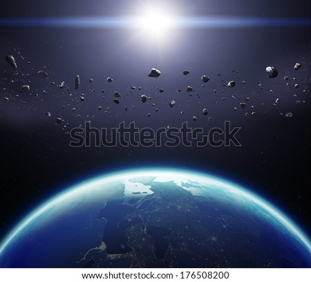 3D Planet Earth with Asteroids. Elements of this image furnished by NASA. - stock photo