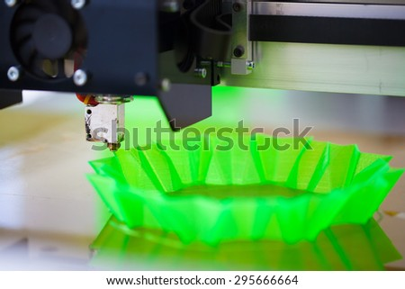 3d printer in action, printing abstract green shape - stock photo