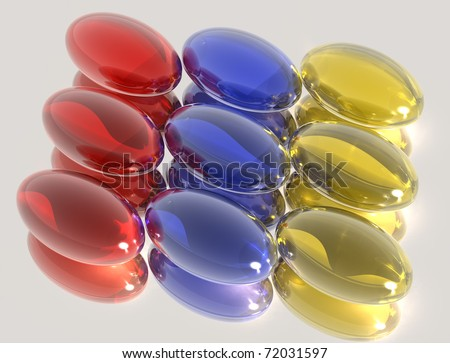 3D red, blue and yellow pills - stock photo