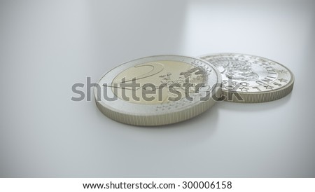 3 D render of two Euro coins on a white reflective surface. One coin is laying on a white surface while the other is leaning on other. One is showing head, the other tail.  - stock photo