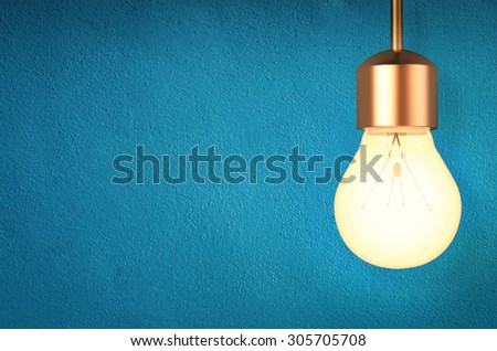 3d rendered hanging light bulb on blue background - stock photo