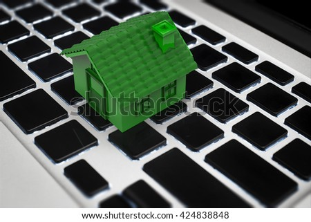 3d rendering green house on keyboard - stock photo
