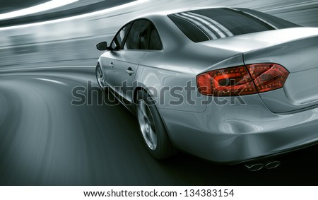 3d rendering of a brandless generic car of my own design in a tunnel with heavy motion blur - stock photo