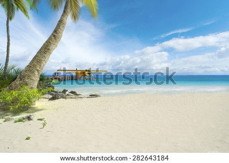 3D rendering of a floatplane at the end of a pier on a tropical beach - stock photo