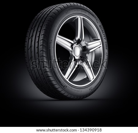 3d rendering of a single car tire on a black background - stock photo