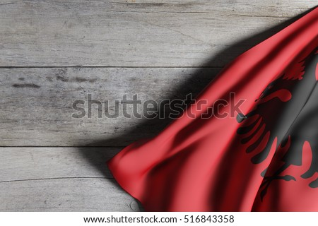 3d rendering of an Albania flag on wooden background.
