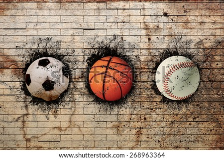 3d rendering of basketball, baseball and soccer ball embedded in a brick wall - stock photo