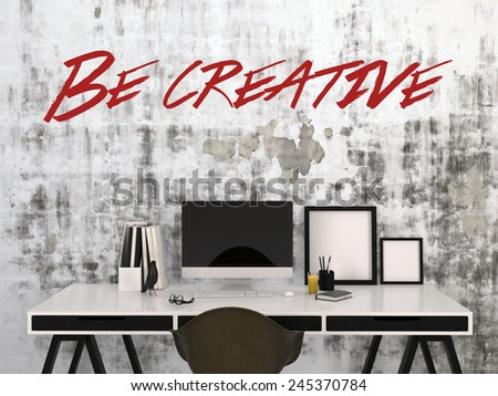 3D Rendering of Be Creative concept with the text in red on an abstract grey wall above a stylish black and white desk with desktop computer, photo frames , and pens in a business or home office - stock photo