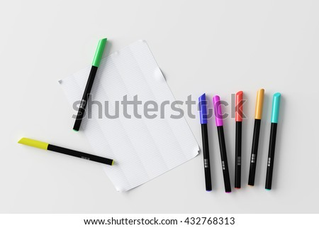 3d rendering of bright colorful pens with sheet of paper on white background
