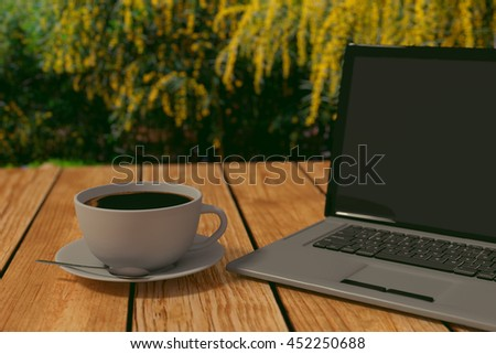 3D rendering of Coffee and laptop on a wooden table in the park, coffee focused