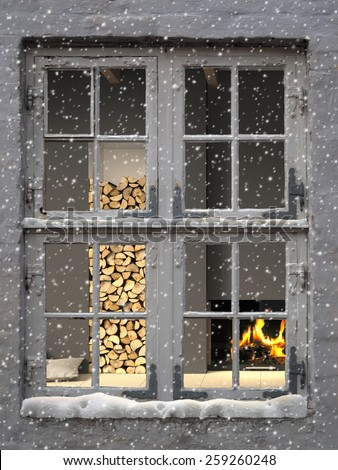 3D rendering of cozy warm interior seen  through an old window while snow falls - stock photo