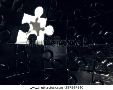 3d rendering of jigsaw sphere puzzle with one piece light window glow. Succes concept - stock photo