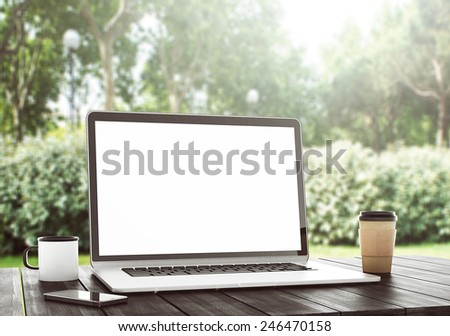 3d rendering of laptop on table - stock photo