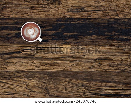 3D Rendering of Overhead view of a mug of freshly brewed coffee or hot chocolate on a wooden desk with wood grain pattern and copyspace - stock photo