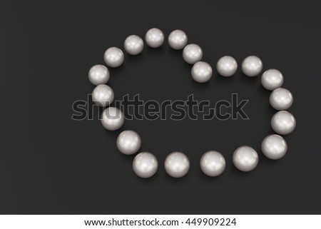 3D rendering of pearls shaped as a heart on a black background - stock photo