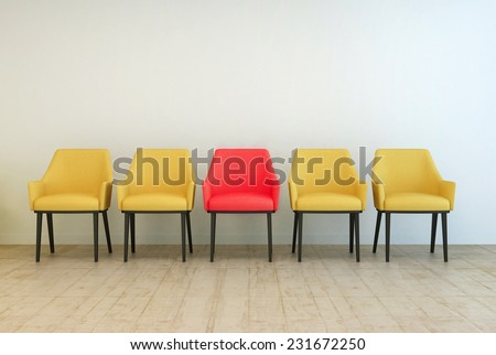 3D Rendering of Row of yellow empty chairs aligned against a grey wall of a lobby or a waiting room, with a red one in the middle, concept of making a difference - stock photo