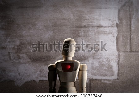 3d rendering of wooden mannequin toy prototype of human with a red heart, conceptual.