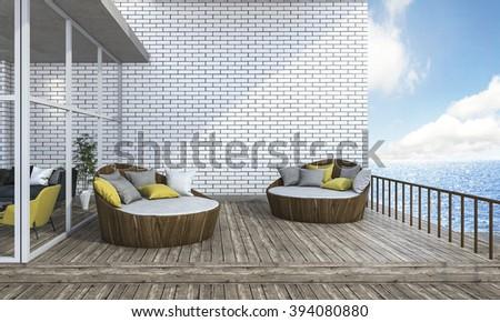 3d rendering round sofa on plank terrace near the sea - stock photo