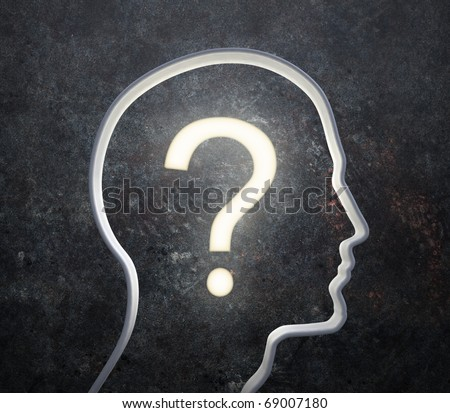 3D silhouette of a male face with a glowing question mark - stock photo