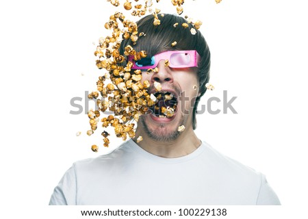 3d technology conceptual photo of young man in stereo glasses eating popcorn - stock photo