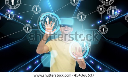 3d technology, virtual reality, cyberspace, network and people concept - happy young man in virtual reality headset or 3d glasses touching contact icons on screen over black background and laser light