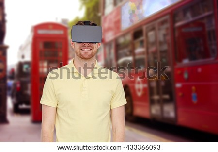 3d technology, virtual reality, travel, entertainment and people concept - happy young man with virtual reality headset or 3d glasses over london city street background