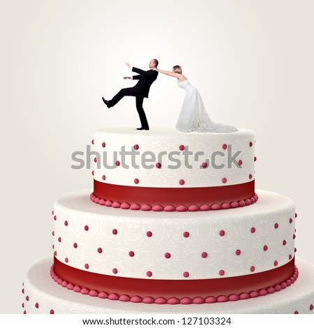 3d wedding cake and funny couple situation - stock photo
