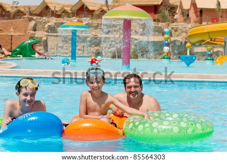 Dad and kids in the pool