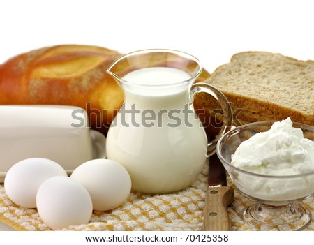 dairy products and Fresh eggs  in glass containers - stock photo
