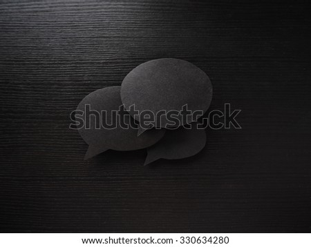 dark set of speech and thought blobs, three clouds for text made from Real materials, paper, wooden background - stock photo