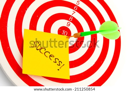 2 dart green and yellow color right on target with text success isolated on white background - stock photo