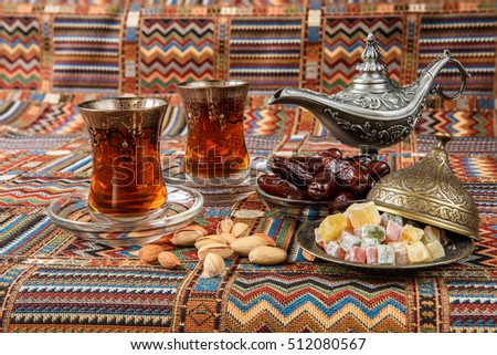 dates and tea on a traditional Arabian carpet