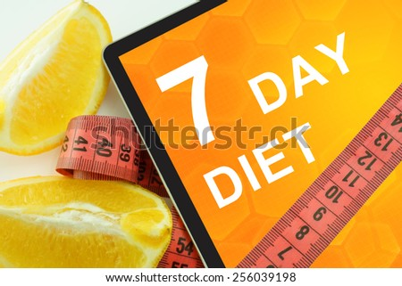 7 day diet on tablet.  - stock photo