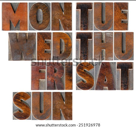 7 days of week (first 3 letters) - isolated text in vintage wood letterpress printing blocks, - stock photo